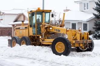 snow plow removing snow