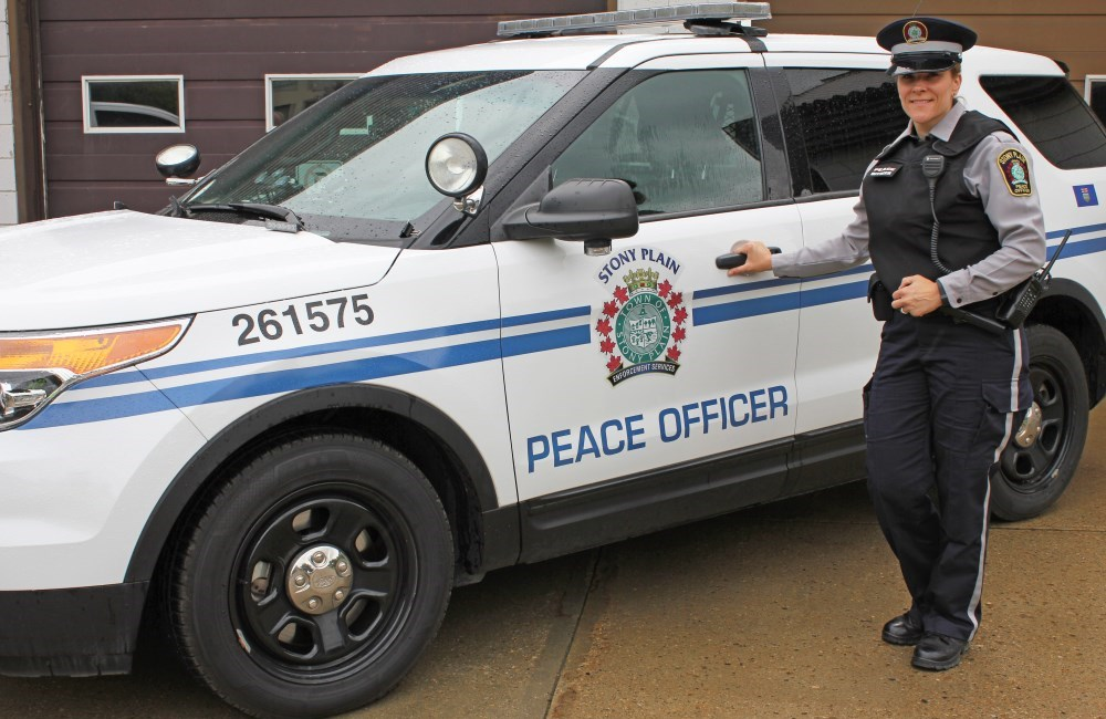 peace officer in front of vehicle