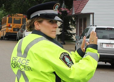 Peace officer directing traffics
