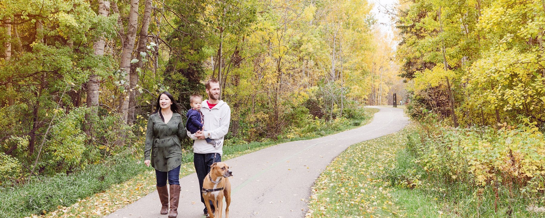 family walking on path in fall